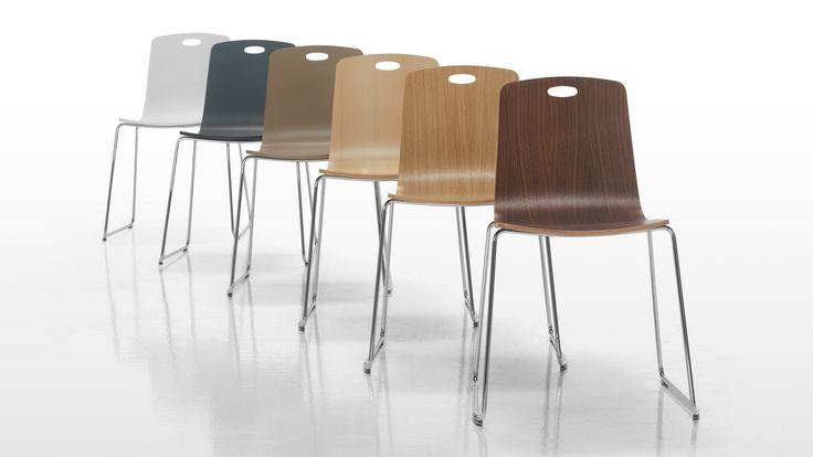 Ann from Sandler Seating. Stacking chairs with optional cut-out detailing on the back.
