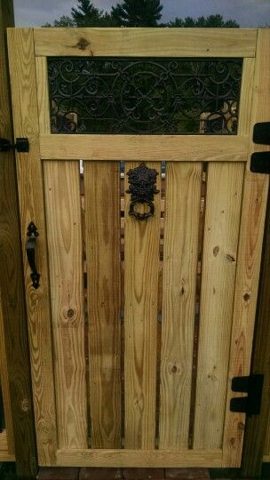 Self closing pool gate with metal accents for above ground pool.