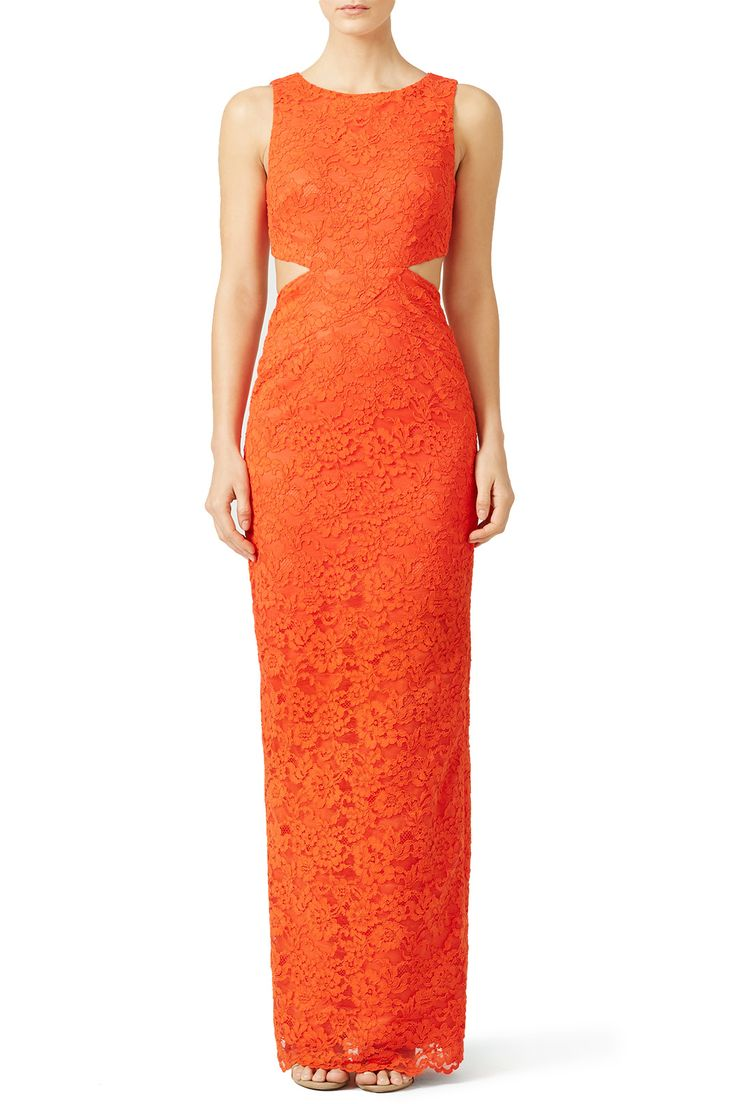 Side cut-outs give this orange Nicole Miller gown a modern twist. Try the lace look with strappy sandals for a wedding reception.