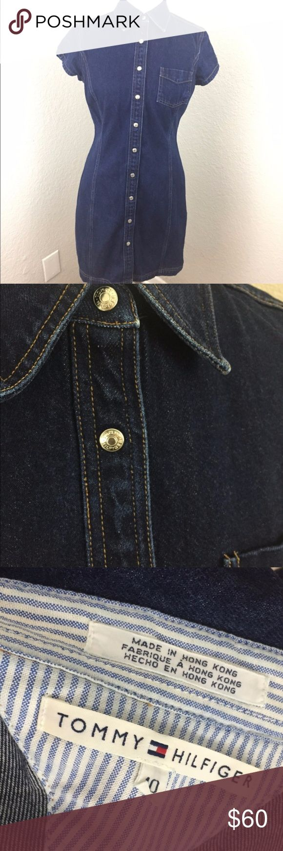 Tommy Hilfiger Denim Collared Dress With Pocket • Push buttons with engraved logo. • Front pocket. • Missing logo panel on sleeve (pictured). • Small stain next to missing logo panel (pictured). • Garment is 100% cotton. Tommy Hilfiger Dresses Mini