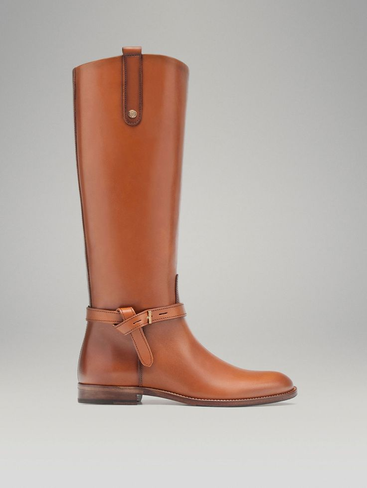 Love the rich color & classic style - Massimo Dutti LEATHER RIDING BOOT $ 280.00 Brushed nappa boot with knotted strap detail, metal buckle, pull-tab and stud with engraved logo. Cowhide leather lining and rubber-injected leather sole.
