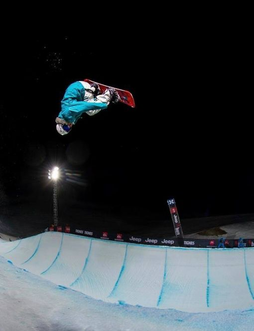 Bex Sinclair riding halfpipe at night during Euro X - You can see Bex is doing a flip trick, called a Crippler