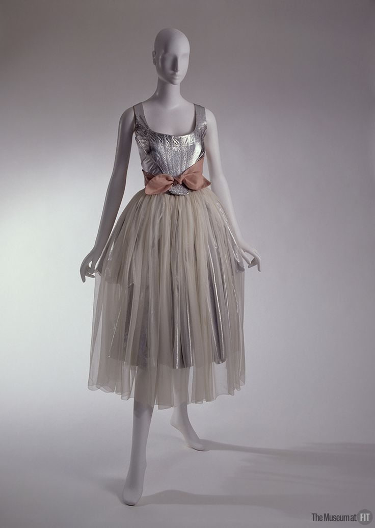 Vivienne Westwood evening ensemble, Time Machine collection, fall 1988. From the collections of The Museum at FIT #FairyTaleFashion http://exhibitions.fitnyc.edu/fairy-tale-fashion/  Vivienne Westwood's metallic silver ensemble is a contemporary take on an 18th-century court gown. In Steven Guarnaccia's storybook, Cinderella: A Fashionable Tale, Cinderella decides on this dress to wear to the ball. Westwood's imaginative designs are frequently described as having a fairy-tale quality.