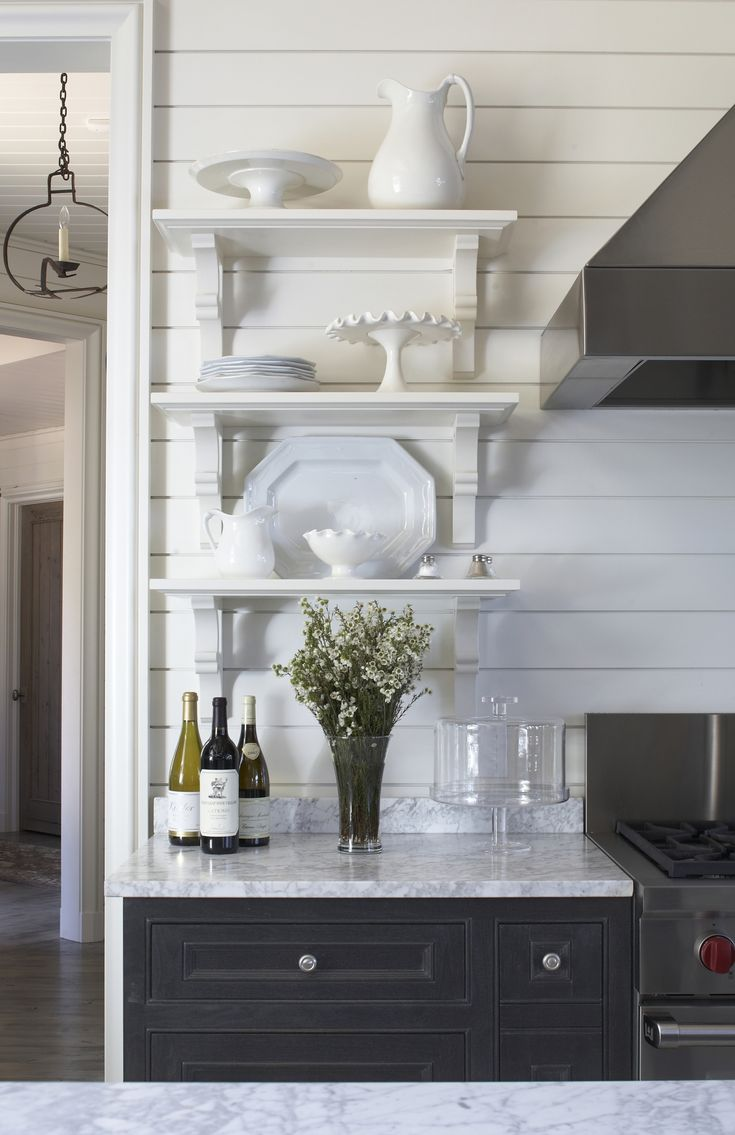 Small open shelving. I like that but look at the light fixture hanging on the left in background!