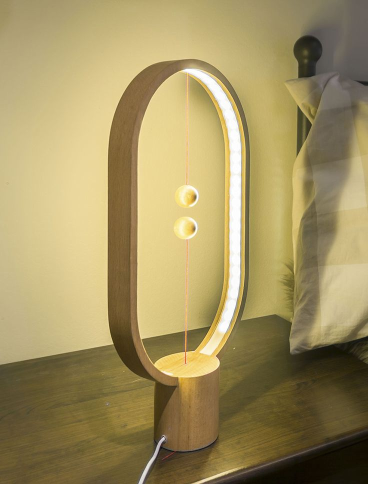 Wooden Lamp With Levitating Switch Li Zan Wen, a Chinese designer came up with the HENG Balance Lamp Read more at: http://www.beautifullife.info/industrial-design/wooden-lamp-levitating-switch/