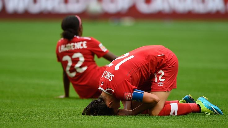 VANCOUVER, BC - JUNE 27: Christine Sinclair and Ashley Lawrence of Canada are distraught at the end of the FIFA Women's World Cup 2015 Quarter Final match between England and Canada at BC Place Stadium on June 27, 2015 in Vancouver, Canada. (Photo by Mike Hewitt - FIFA/FIFA via Getty Images)