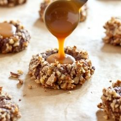 These chocolate turtle cookies - gooey caramel nestled in a chocolate cookie coated in toasted pecans - are outstanding. Christmas cookie exchange?