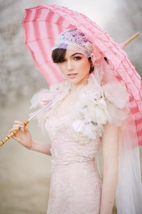 Love the styling and the shades of pink... parasol a must have!!