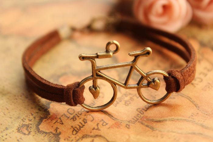 bike bracelet, retro bronze love bike alloy bracelet, brown wax rope chain bracelet---B163. $3.89, via Etsy.