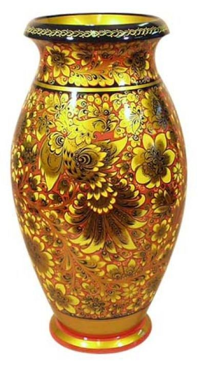A wooden vase decorated with folk Khokhloma painting from Russia.