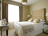 upholstered bed in small bedroom