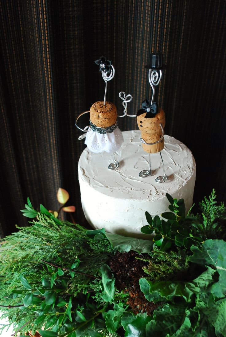 Rustic Champagne Cork Wedding Cake Toppers. These can be PERSONALIZED WITH YOUR WEDDING DATE! Handmade in the PNW with satin bows, country lace, entwined arms in the shape of a heart, & topped with a top hat! Beautiful and elegant addition for your wedding decor. These toppers also can be used as tree ornaments for a lasting keepsake.