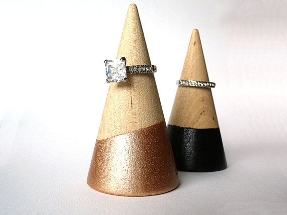 Display your rings in a unique way with this wood ring cone! Painted bottom makes the cone stand out. Great accessory to gift with a ring.