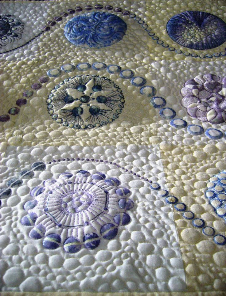 """Close-up, """"Pearls are not always white"""" by Sheena Norquay (UK).  Photo and text by Lisa O'Neill:  It was inspired by strands of pearls. The circle detail is stenciled, and all of the quilting is free motion."""