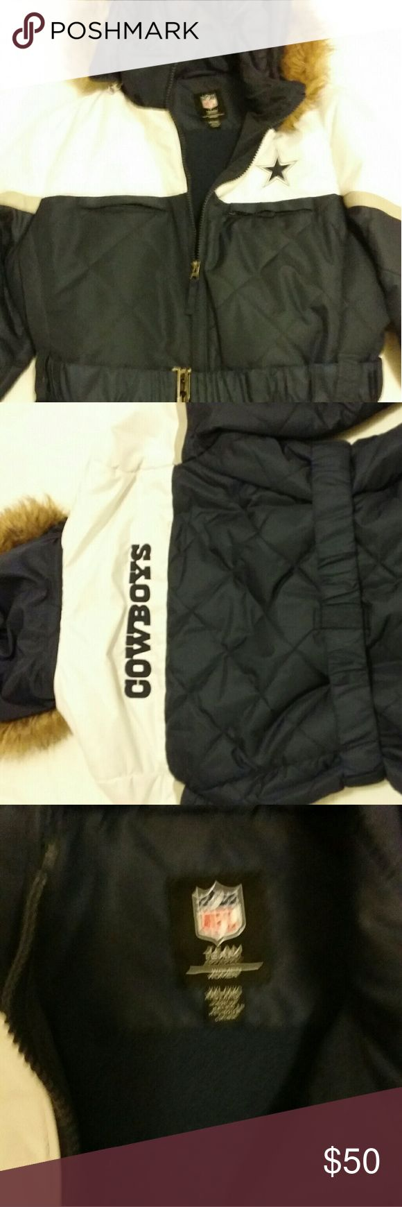 """Coat XXL Womens coat Preowned Dallas Cowboys belted coat women XXL This beauty has six pockets!!!! 2 inside; 2 chest, and  2 waist. adjustable velcro at the wrist, fleece lining and like new condition.  Flat measurements are as follows: ARMPIT TO ARMPIT 25"""", Sleeve length 25"""" shoulder to shoulder 18"""", waist 24"""" Keep in mind that this coat is belted NFL Apparel Jackets & Coats Puffers"""