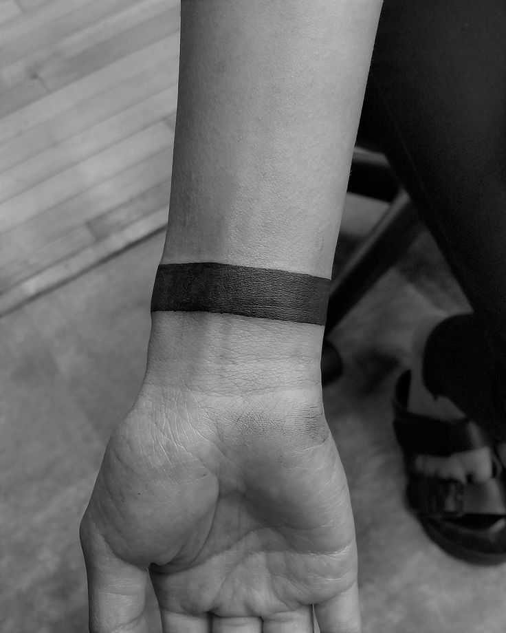 Tattoo done by Jake Faldet at Firehouse Tattoo in Stoughton WI  black work, black band tattoo, wrist tattoo, arm tattoo, black and white, tattoo shop, wisconsin tattooer, cover up tattoo