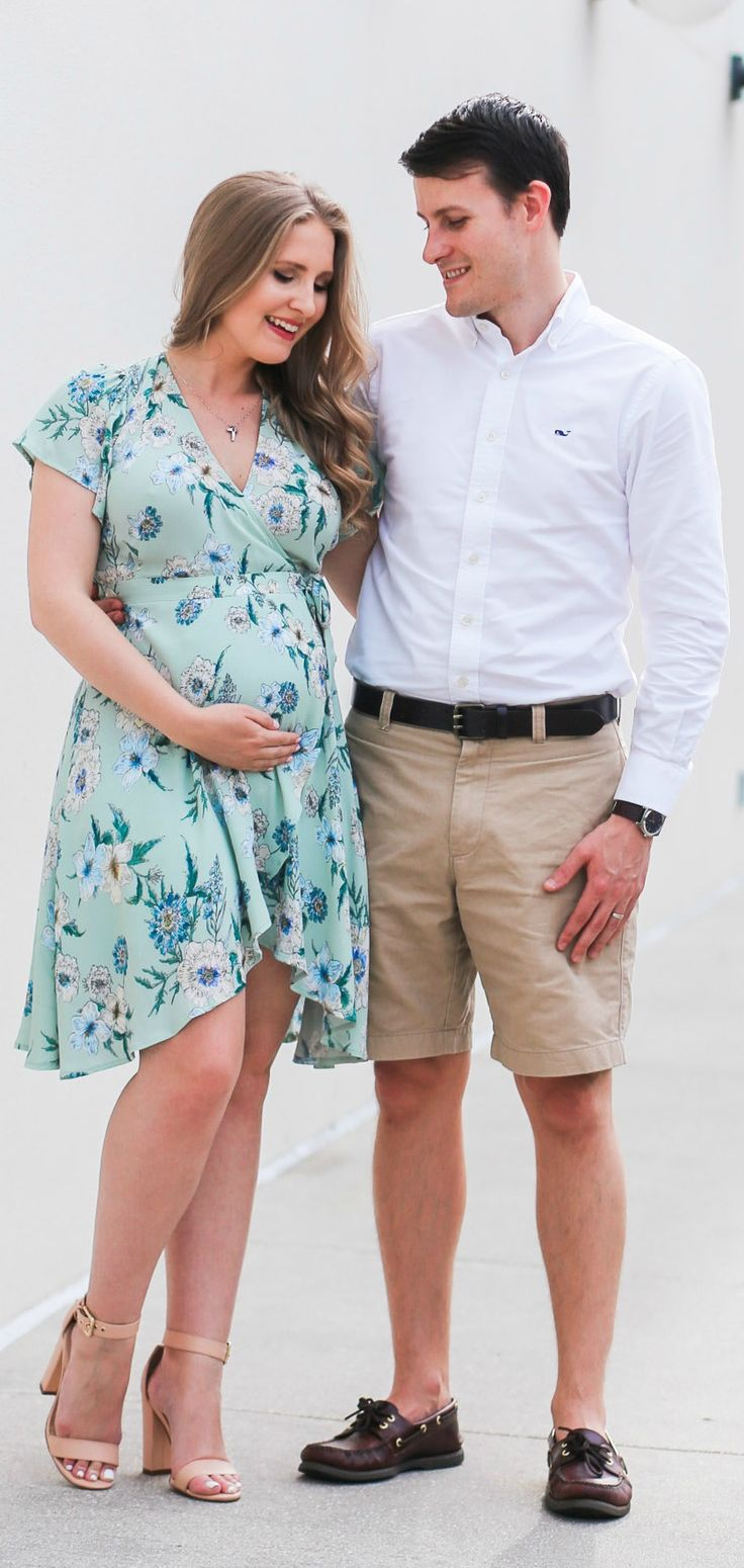 Cute pregnancy announcement photo idea | Rose gold Oh Baby balloons | ASTR pale green floral wrap dress | Flattering maternity dress | Florida beauty and fashion blogger Ashley Brooke Nicholas