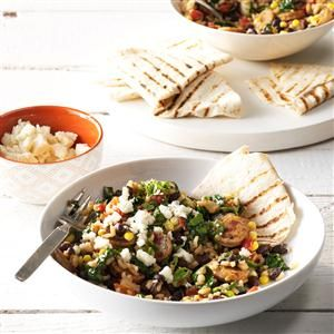 Chorizo Burrito Bowls Recipe -I'm always on the hunt for fast and filling meals. Chicken sausage makes an awesome one-dish dinner by itself or served with brown rice in a burrito. —Elisabeth Larsen, Pleasant Grove, Utah