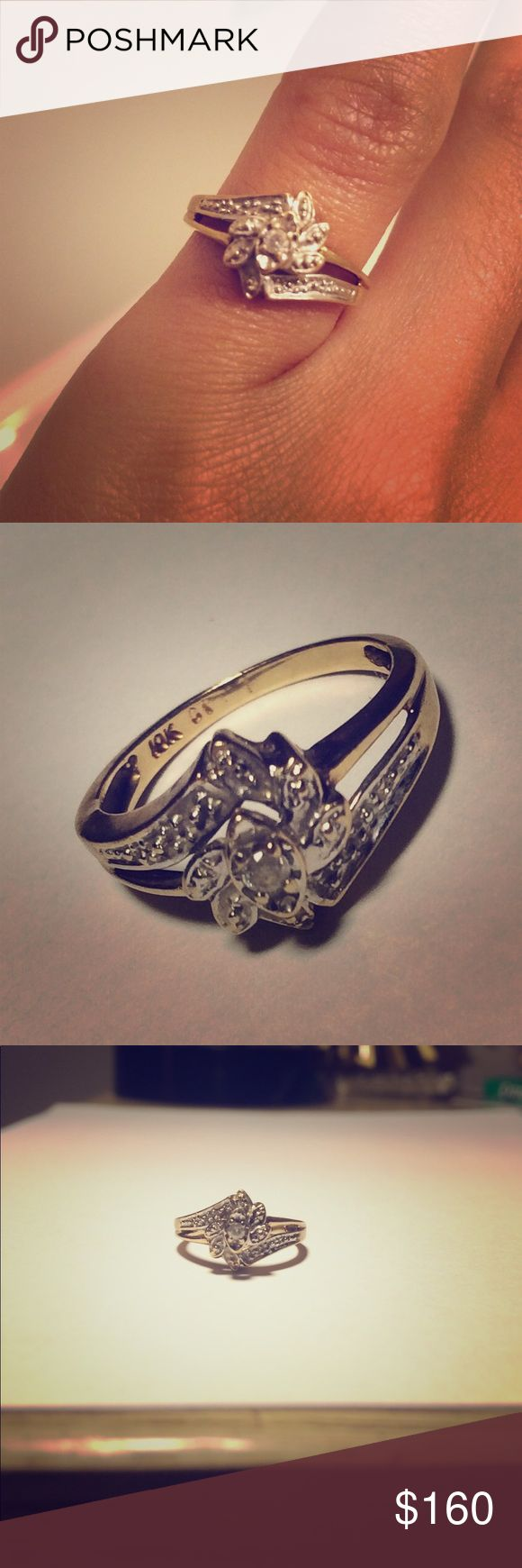 Diamond Wedding Ring With 10K Gold 10 K gold diamond wedding ring with flower design. The size of the only diamond is about a tenth of a karat. Jeweler has confirmed authenticity. Size 4 ( 1.4cm in diameter) Jewelry Rings