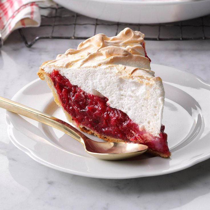 Mile-High Cranberry Meringue Pie Recipe -Your holiday crowd will be blown away when they see this pie with towering meringue on top. Let it sit in your refrigerator for at least four hours for best results. —Marcia Whitney, Gainesville, FL