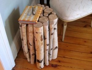 Branch Side Table This is a cheap and easy DIY version to those pricey log tables you see sold in stores. by TheUnfashionista