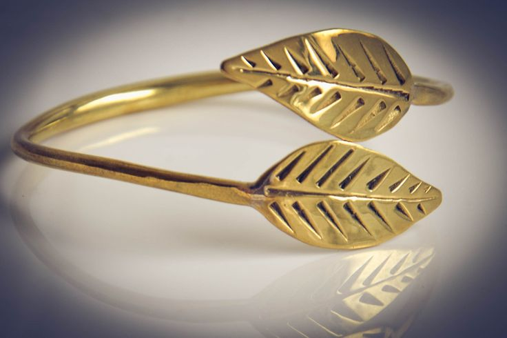 Adjustable handmade brass bangle with intricate leaf design.    Part of our artisan jewellery 'Gold' collection which is handmade by a local artisan in Siem Reap, Cambodia from recycled brass bullet shells.  Available now at www.banteaysreyboutique.com