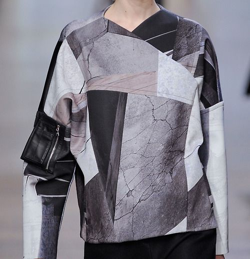 Photo marble patchwork gives sleek angles to this utilitarian top featuring an arm pouch with zipper detail at @yigalazrouel #nyfw #aw14