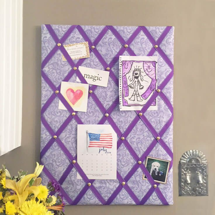 Make your own DIY ribbon bulletin board that's both pretty and useful! Customize them with different fabrics and ribbons for great gift ideas.