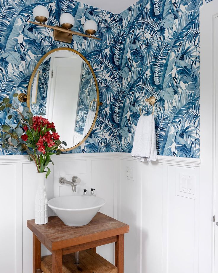 Glam beach house bathroom with teal palm leaf wallpaper