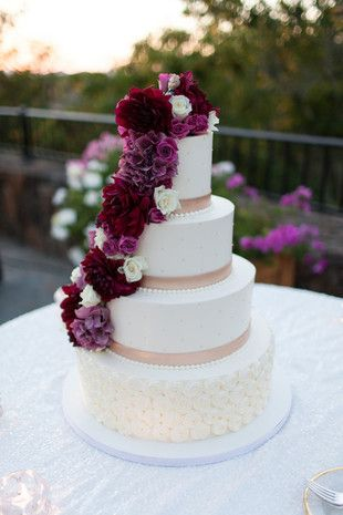 Top 16 Wedding Cakes of 2015: Romantic wedding cake idea - cascading deep purple and red flowers {Megan Clouse Photography}