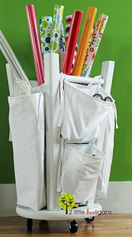 Creative Storage Hacks For an Organized Home --> DIY Wrapping Paper Organizer from an Old Kitchen Stool Turned Upside Down #tips #organizing #storage