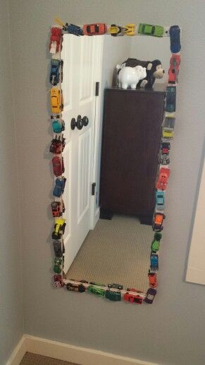 Hot Wheels + E6000 on a white mirror. Super cute diy project for a little boy's room!