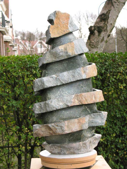 """ External pealing of a Serpentine Stone""  Karel Vreeburg sculpture"