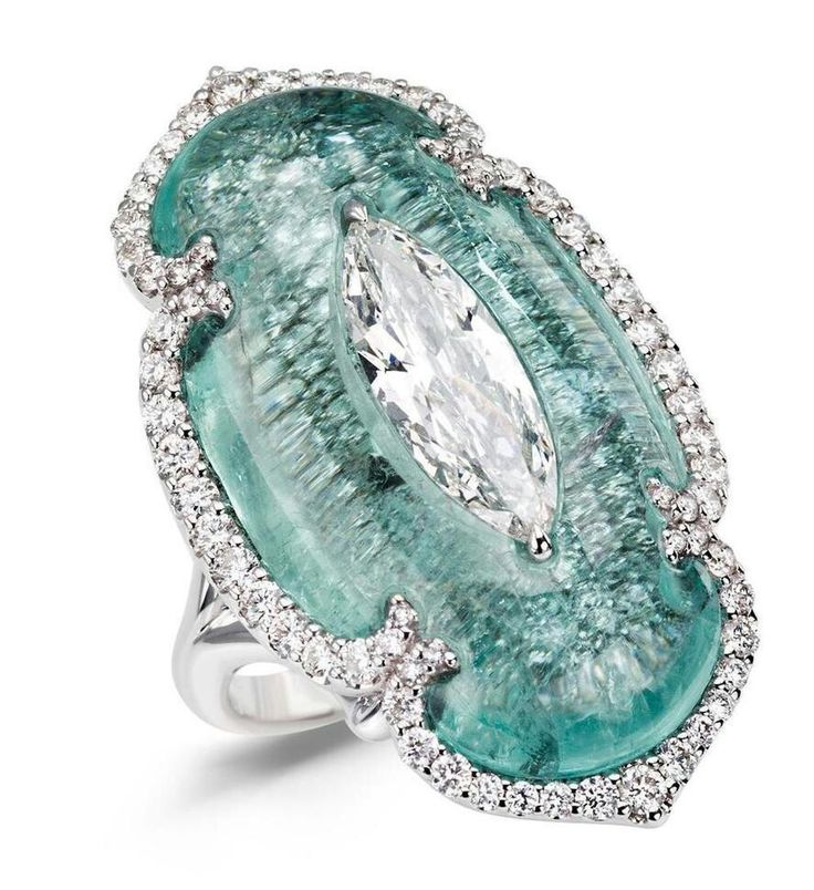 Art of Inlay - marquise-cut diamond and Paraiba tourmaline ring. The two main stones in this one-of-a-kind ring have been mounted using the Art of Inlay technique that seamlessly sets one stone inside another.