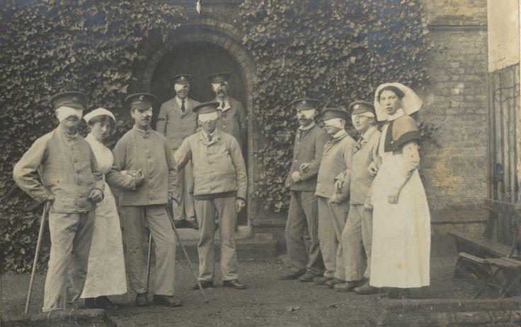 Nurses guiding a group of World War One veterans in bandages #blindveteransuk #blind #veterans #worldwarone #ww1