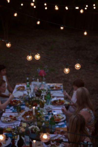 Image Via: Camille Styles | I want to hang lights above my dinner table and have with where we turn the lights low and eat by candlelight on certain days of the week. or eat outside. something to switch it up.