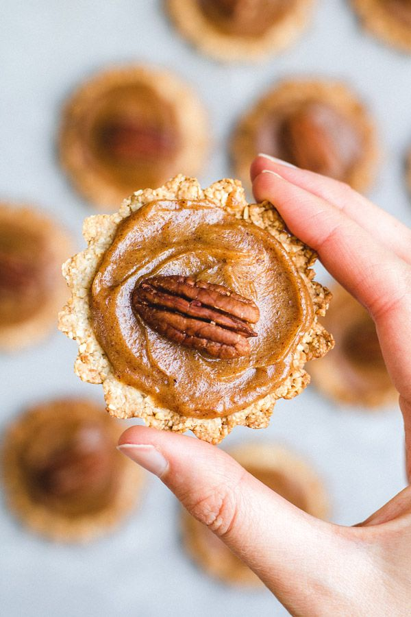 These healthy mini pecan pies make the perfect holiday dessert. They're vegan, gluten-free, and refined-sugar free so they can be enjoyed by everyone!