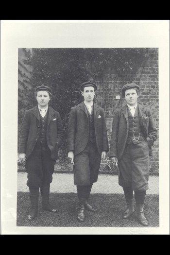 Three women wearing Kew Garden gardener uniforms, circa 1900