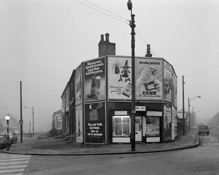 Shopfronts, Huddersfield, England, United Kingdom, 1974, photograph by Chris Killip.