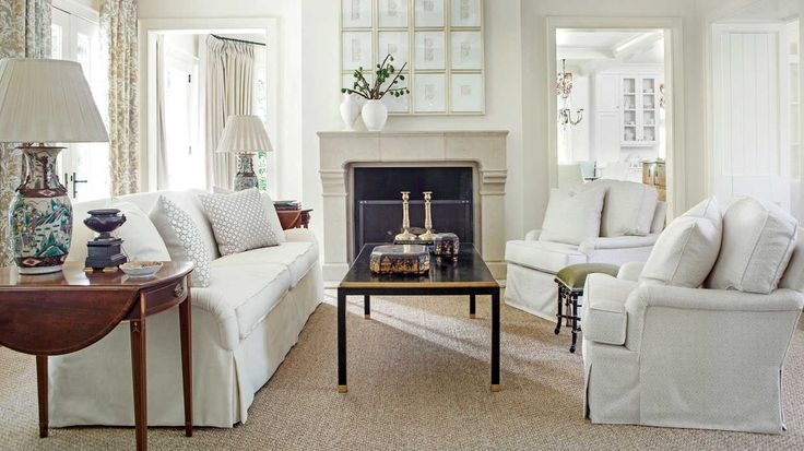 Serene White Living Room by Suzanne Kasler - with an artwork cabinet that hides the TV - photo by Laurey W. Glenn