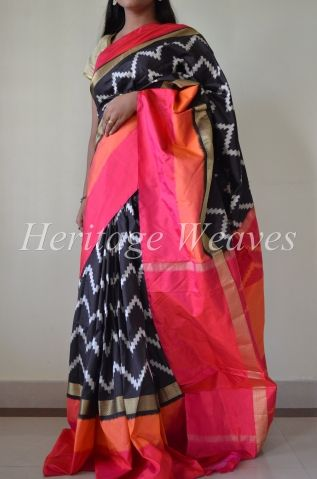 Chevron design ikat soft silk saree in black, pink and orange.