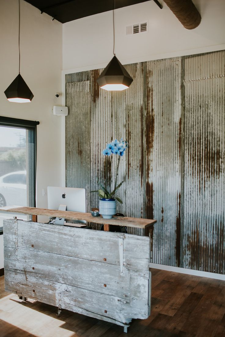 barn door reception desk made with reclaimed wood and metal wall - Salon Ideas Design