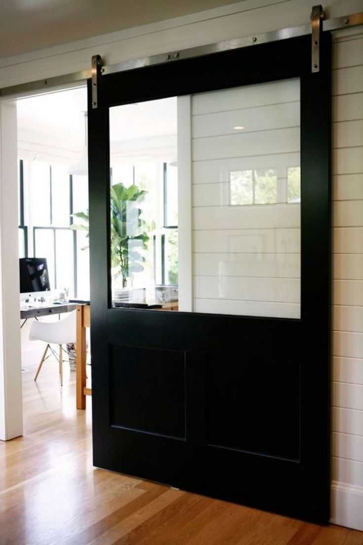 porte coulissante suspendue - cadre noir et fenêtre en verre
