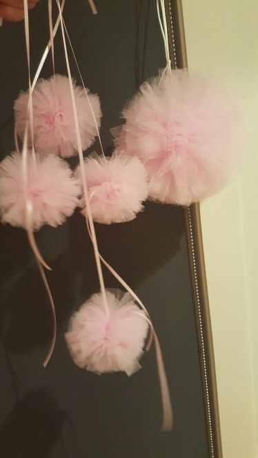 Pink pon poms for baby shower