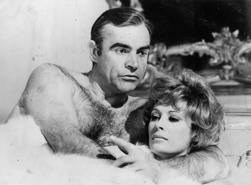 """Artist: Terry O'Neill  Title: Sean Connery and Jill St John 2 007  Scottish actor Sean Connery as James Bond and Jill St John in bed during the filming of 'Diamonds Are Forever', 1971.  Limited Edition Silver Gelatin Signed and Numbered  12"""" x 16"""" / 16"""" x 20""""  20"""" x 24"""" / 20"""" x 30""""  24"""" x 34"""" / 30"""" x 40"""" / 40"""" x 60"""" / 48"""" x 72""""  For questions or prices please contact us at info@igifa.com       IGI FINE ART"""