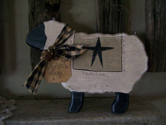This sheep is made from wood and measures approximately 10 wide by 7 high. I have painted it an antique white. I have speckled him with black paint for a prim look. He also has a black and tan homespun material around his neck with an added rusty bell. This sheep will look great in any country or primitive setting. Please convo me if you have any questions. Thanks and God Bless