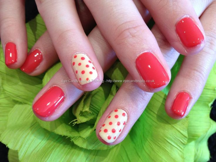 Bright coral gel overlay with odd pastel yellow and coral polka dot nail art