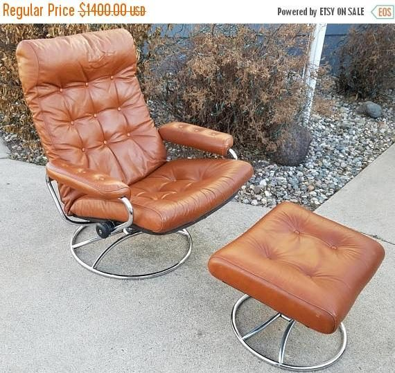Vintage Ekornes Stressless Lounge Chair and Ottoman in Brown Leather, Scandinavian Mid Century Reclining , Made by J.E. Ekornes Fabrikker AS, Made in Norway This retains its original Ekornes made in Norway tags  The tufted leather is in great vintage condition with little wear for