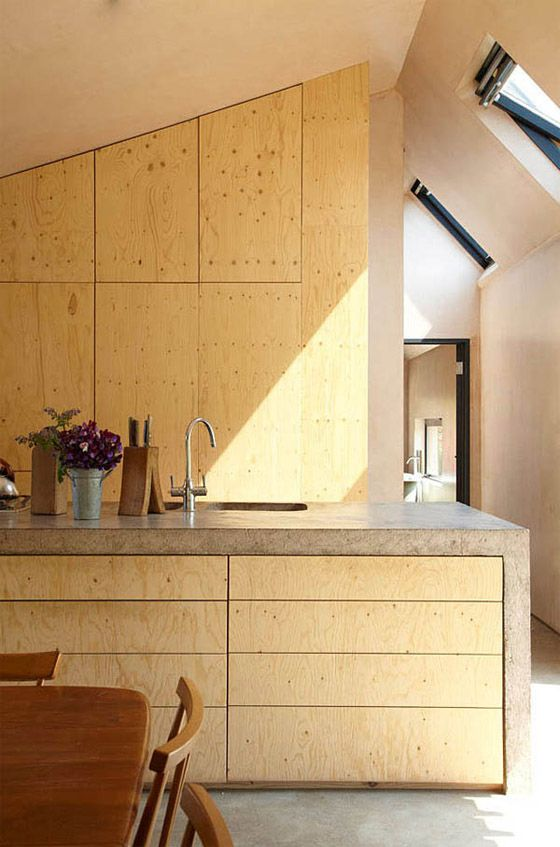 concrete-framed baltic birch cabinetry / invisible studio architects, starfall farm