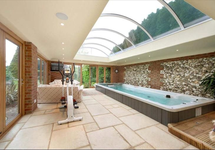 Indoor Endless Pool Swim Spa workout room with gorgeous overhead ...